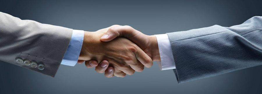 handshake_-_hand_holding_on_black_background_0